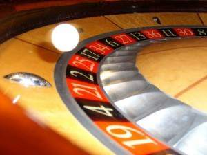 Ball spinning around roulette wheel